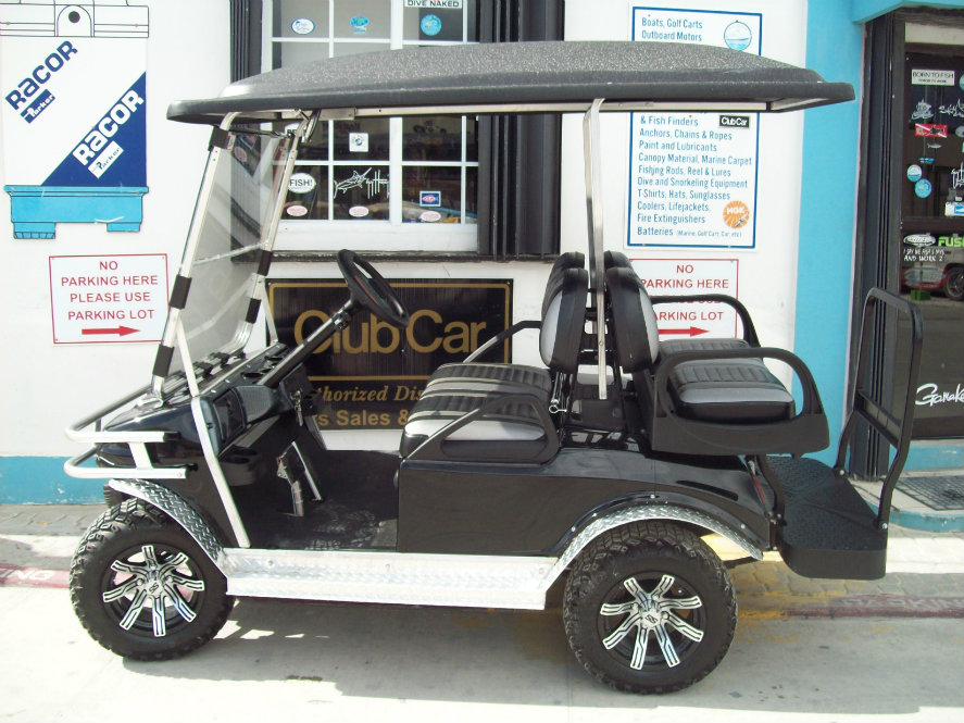 Stainless Steel steering wheel locking Bar * Aluminum Front Bumper * Fold-Down Windshield * Custom Black/Silver upholstery and Canopy Top & Club Car Custom Cart - Captain Sharks Belize Marine Center Boat ...
